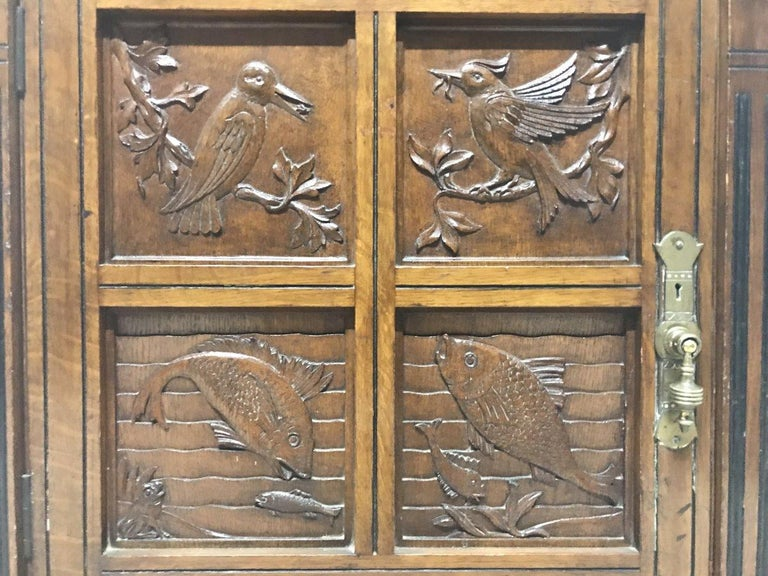 Charles Bevan, Gillows & Co. An Aesthetic Oak Cabinet with Carved Birds & Fish For Sale 1
