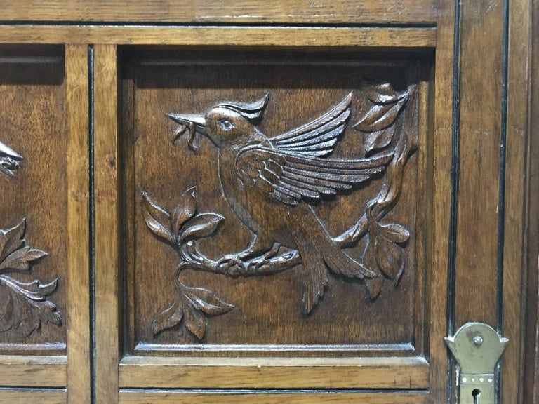 Charles Bevan, Gillows & Co. An Aesthetic Oak Cabinet with Carved Birds & Fish For Sale 3