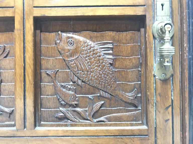 Charles Bevan, Gillows & Co. An Aesthetic Oak Cabinet with Carved Birds & Fish For Sale 4
