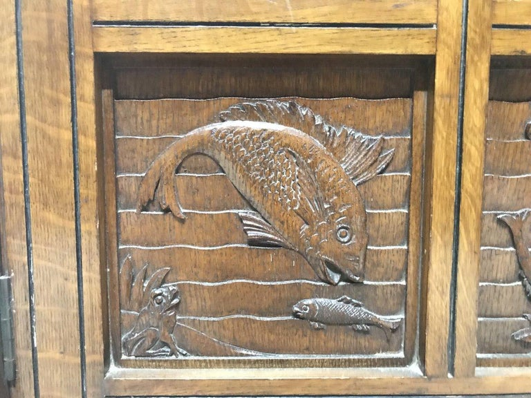 Charles Bevan, Gillows & Co. An Aesthetic Oak Cabinet with Carved Birds & Fish For Sale 5