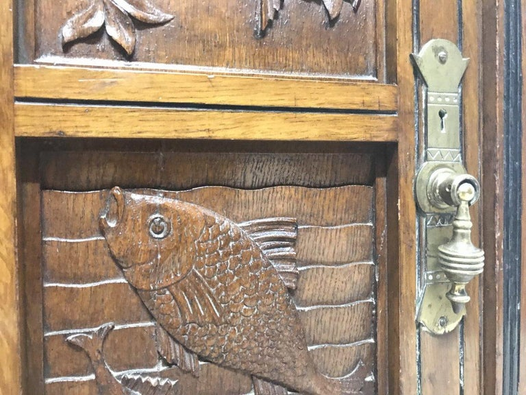 Charles Bevan, Gillows & Co. An Aesthetic Oak Cabinet with Carved Birds & Fish For Sale 6