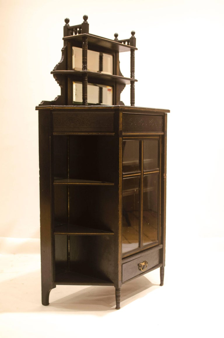 Edward William Godwin made by William Watt, with applied enamel label.