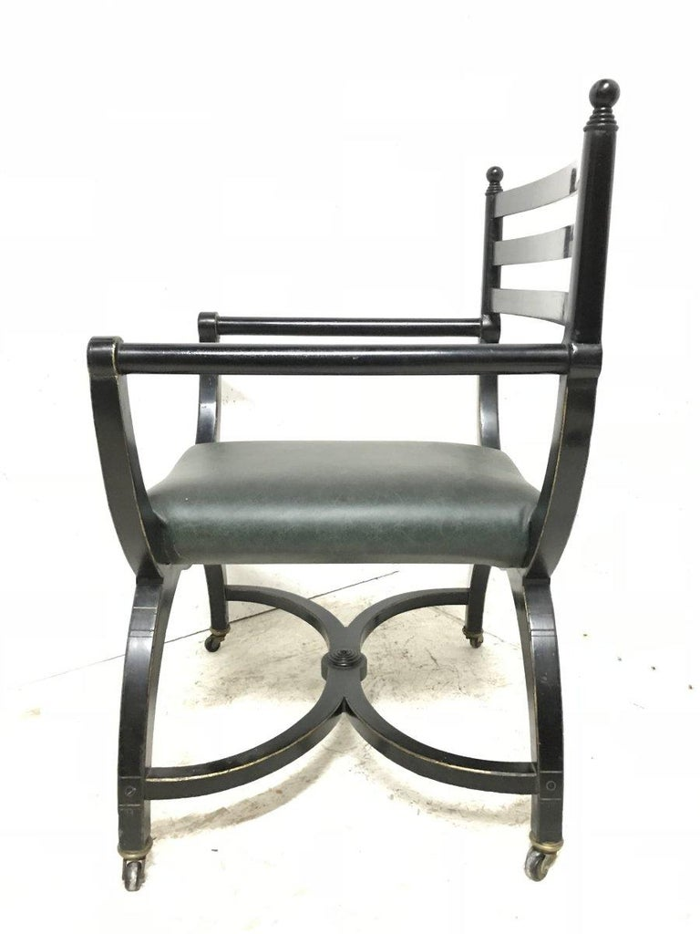 19th Century Richard Charles Aesthetic Movement Ebonised Elbow Chair with X Frame stretcher For Sale