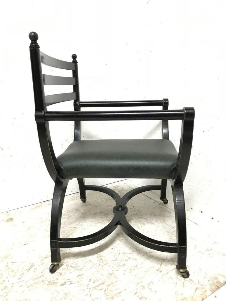 Richard Charles Aesthetic Movement Ebonised Elbow Chair with X Frame stretcher In Good Condition For Sale In London, GB