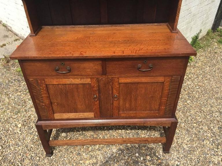 English An Arts & Crafts Craftsman made simple Oak Dresser with Decorative Shaped Top  For Sale