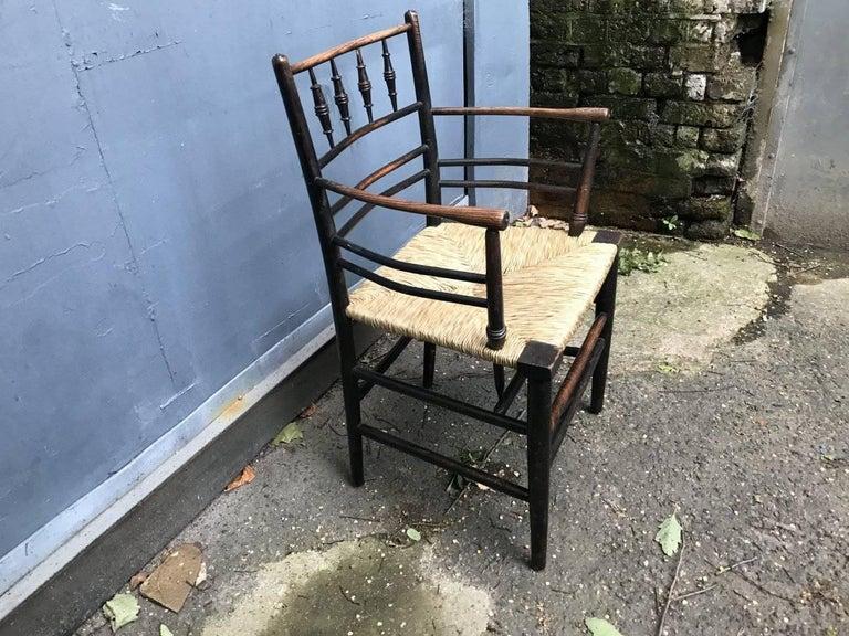 Ebonized William Morris, Twelve Classic Arts & Crafts Ebonised Rush Seat Sussex Armchairs For Sale
