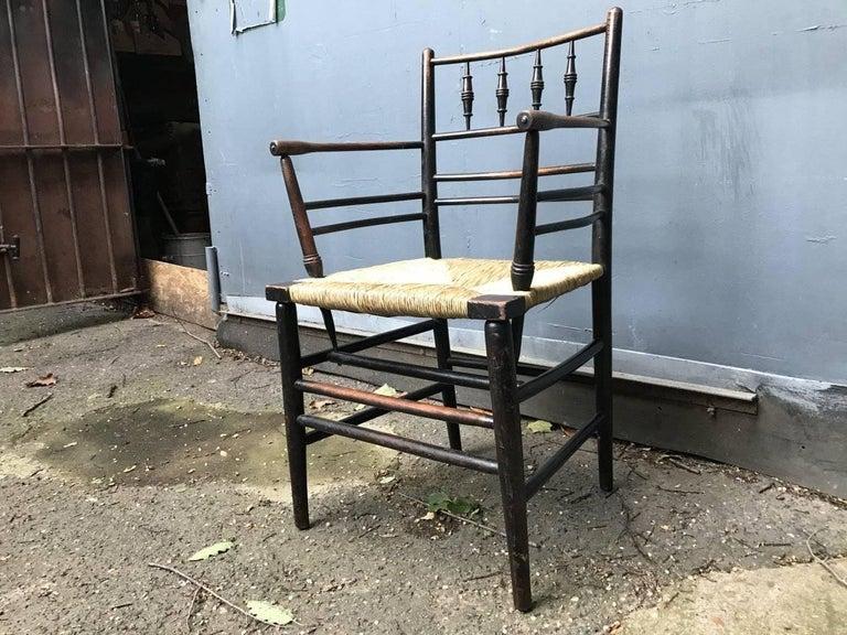 English William Morris, Twelve Classic Arts & Crafts Ebonised Rush Seat Sussex Armchairs For Sale