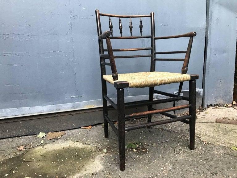 Arts and Crafts William Morris, Twelve Classic Arts & Crafts Ebonised Rush Seat Sussex Armchairs For Sale
