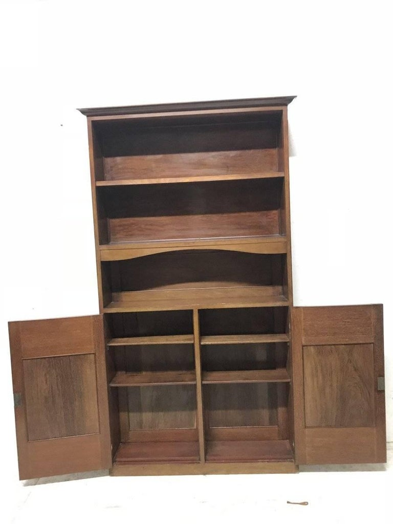 Arts and Crafts Liberty & Co. A Slim Arts & Crafts Walnut Bookcase with Stylised Copper Hinges For Sale