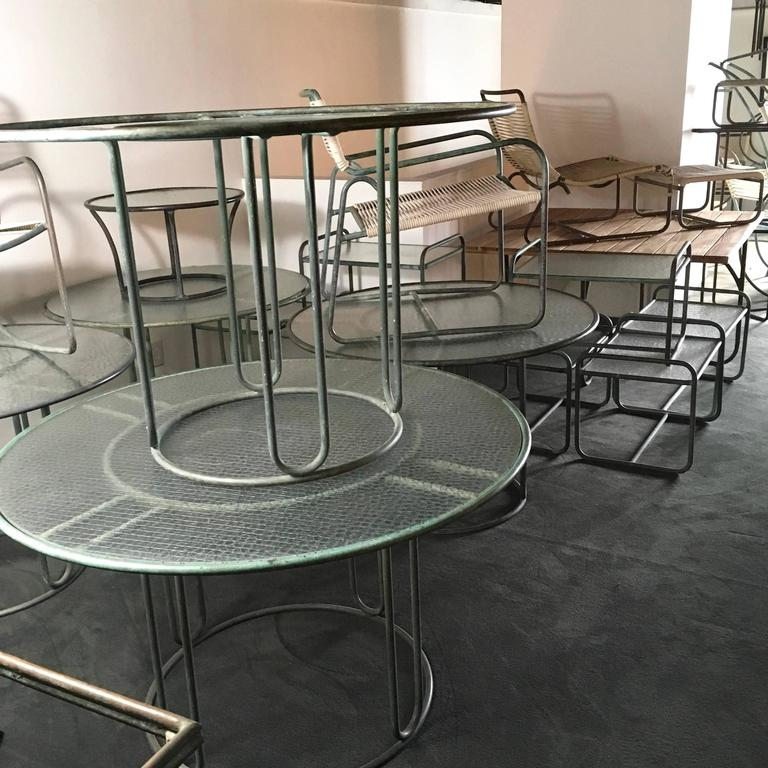 A round dining table of Lamb's.  It has the cylindrical or tubular base. 6 available.