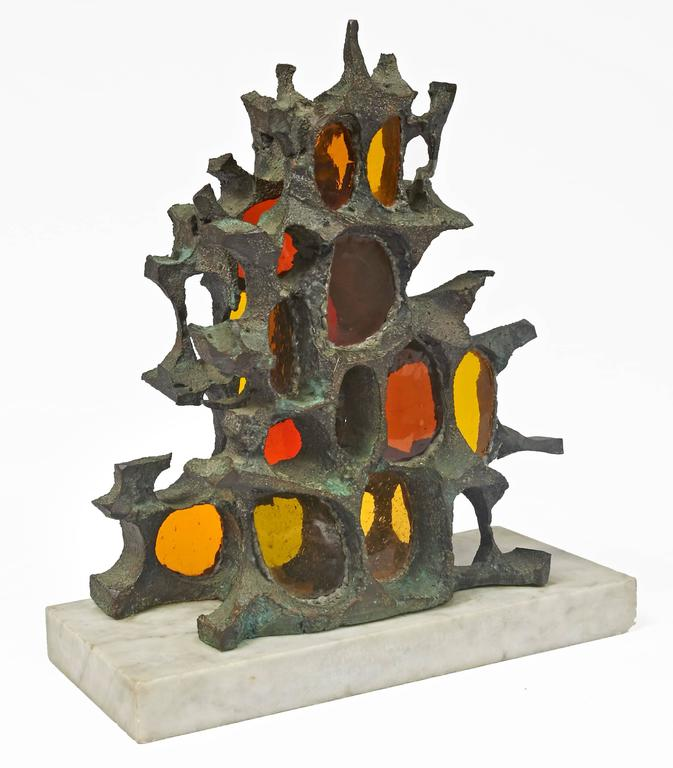 Patinated bronze Brutalist sculpture with colored glass inserts, mounted on carrara marble base.