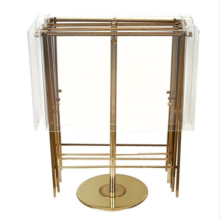 Set of Lucite and brass serving trays on brass stand. These trays have a beautiful profile when opened.