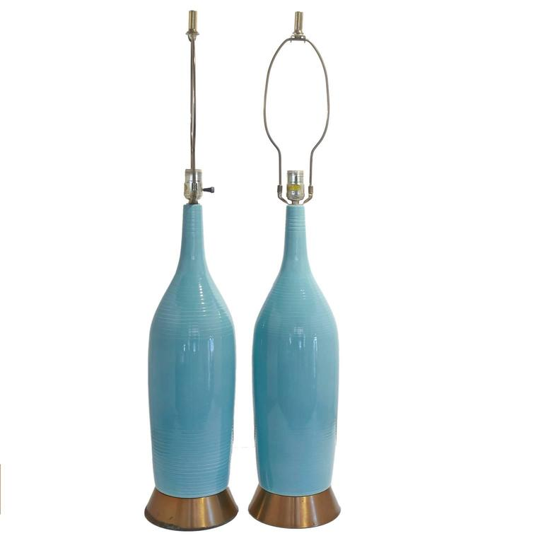 Great pair of turquoise Mid-Century lamps with original shades. 