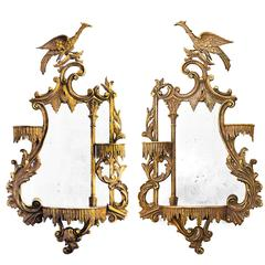 Pair of Opposing Giltwood Carved Eagle Mirrors
