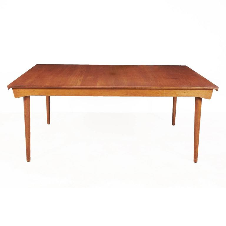 Beautiful solid teak Finn Juhl model FD 540 dining table by France & Son imported by John Stuart, has round John Stuart label on underside of table. The table has two self stored leaves which are hidden when table is closed. Table is 67 inches long