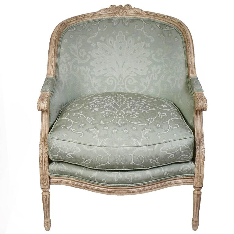 Like new harden French carved armchairs model #3448-000. Original like new light green fabric. Ready to use.