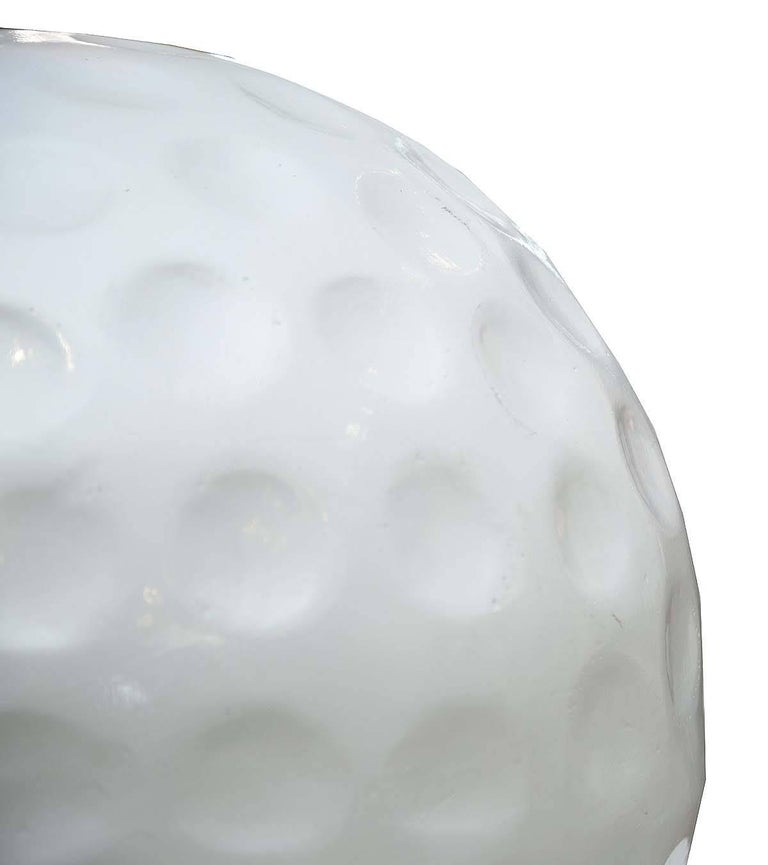 This large sculpture of a golf ball was more than likely an advertising aid. It is detailed and unique.