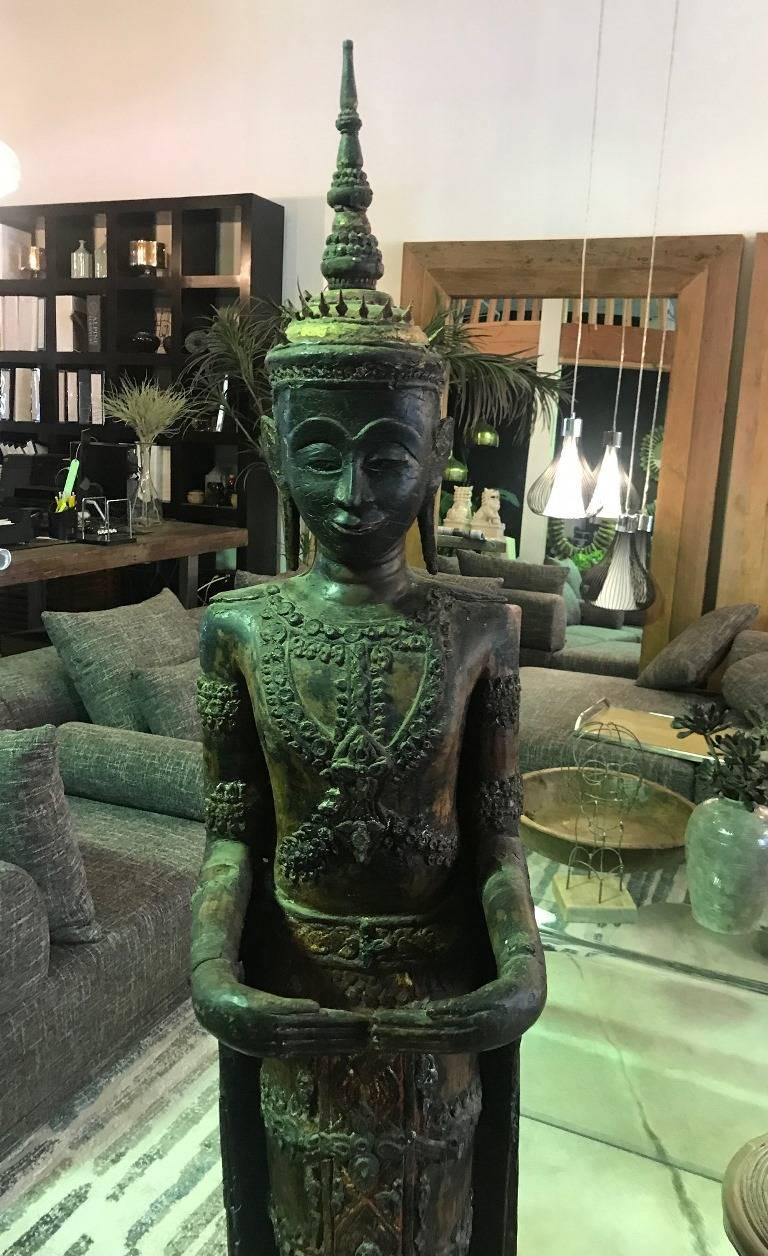 Ornately carved and decorated and standing nearly 6 foot tall. This is truly a mesmerizing piece. Likely Thai but could also be from Laos as they share many similar features and characteristics.   We are listing as 19th century but feel the work