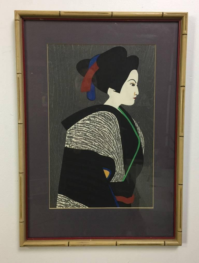 A richly colored and quietly composed portrait/ woodblock print by famed Japanese printmaker Kiyoshi Saito. Many consider Saito to be one of the most important, if not the most important, contemporary Japanese printmakers of the 20th century. This