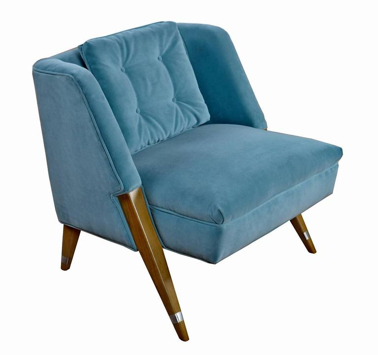 Pair of restored early Mid-Century Modern chairs with distinctive atomic age charm. The petite chairs have been restored with new luxurious serenity blue velvet upholstery. Starkly angled legs and well-padded backs lend comfort to the seated