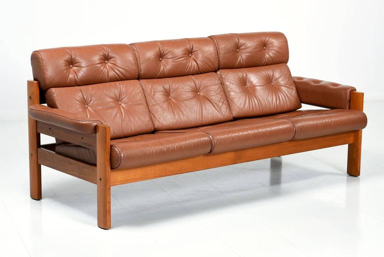Ekornes Tufted Leather And Teak Sofa At 1stdibs
