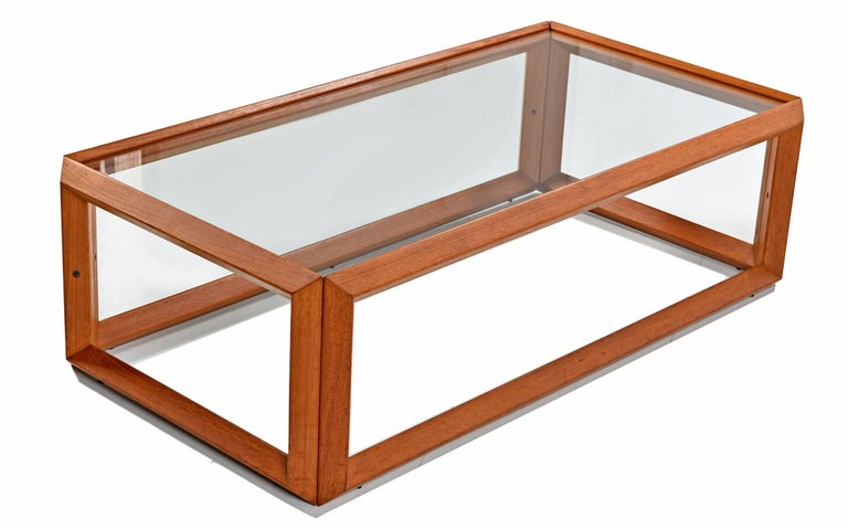 Vintage Danish modern style coffee table and (two) side tables made of solid teak and glass. All with open style teak frames allowing one to see through the form. A single pane of glass rests within the top layer of the frame to create a table