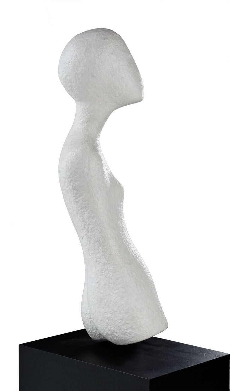 The modern female figurative sculpture exhibits beauty in the simplicity and grace of its form. The artist manages to evoke the subtle essence of femininity while simultaneously eliciting a mystique of the unfamiliar. This Minimalist form blurs the