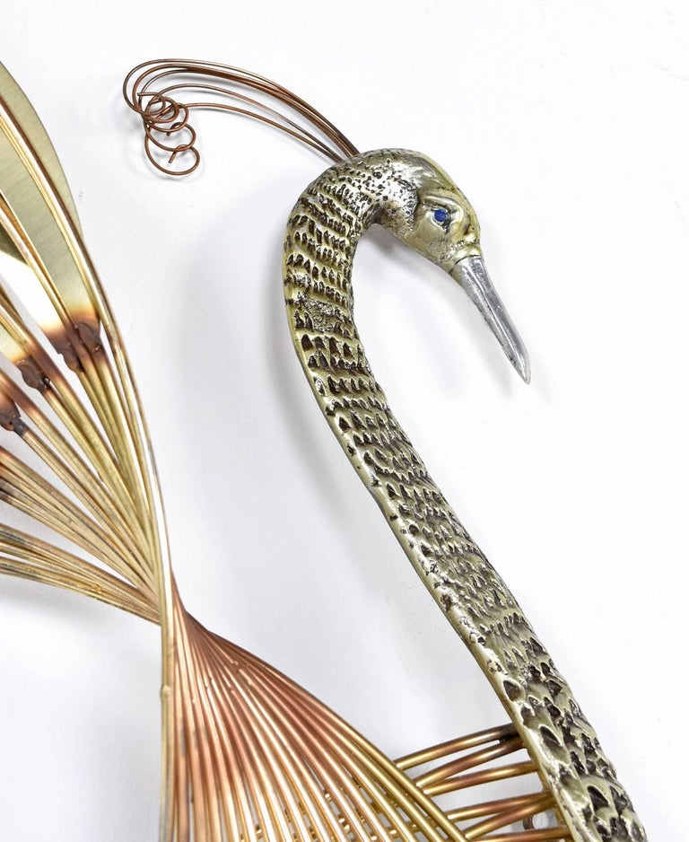 This Hollywood Regency brass peacock bird of paradise by American designer Curtis Jere is breath-taking, even more so in person. The photos simply do not do it justice; you will certainly fall in love with the patina variations that are better