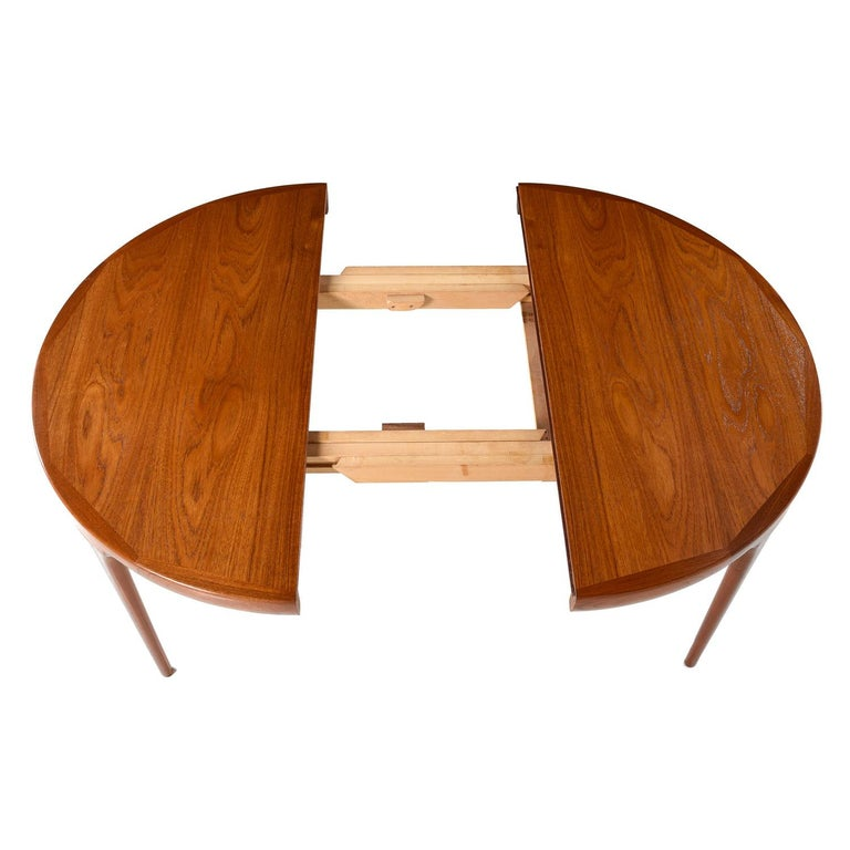 Mid-Century Modern Danish teak dining table by Ib Kofod Larsen for Faarup Møbelfabrik. One of the finest Scandinavian producers of the era. This table bears the the maker's mark and Danish Control stamp. This stamp is reserved for the cream of the