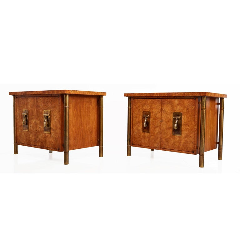 Breathtaking pair of burl wood and brass Mastercraft nightstands. Four tubular outer skeletal brass support legs create a floating effect for each cabinet. The columns are fashioned in the style of bamboo stalks to add an Eastern flare. Hollywood