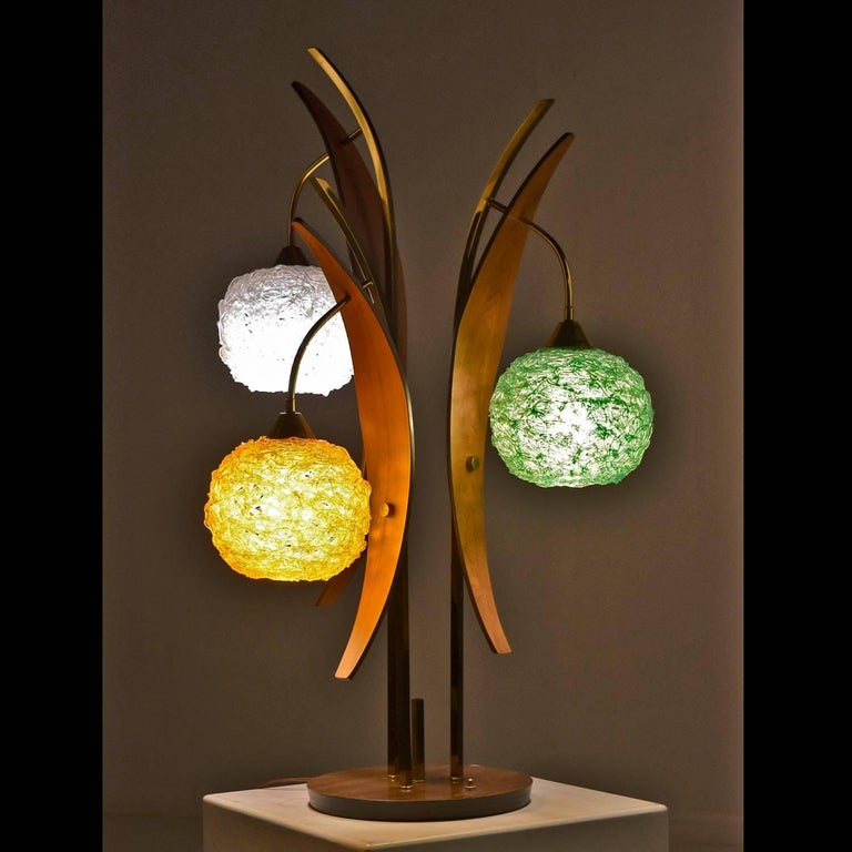 Stunning Mid-Century Modern spaghetti Lucite lamp with three globes and leaf-like walnut accents. This lamp is oozing atomic age charm! Look at the swirling gold rods supporting the three goopy Lucite globes. This iconic retro lamp is a funky