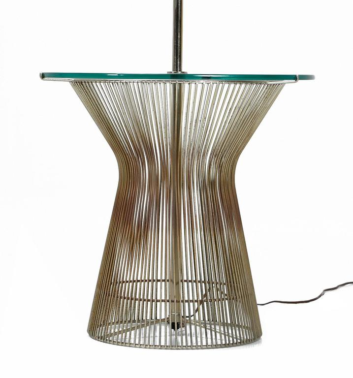 Vintage laurel floor lamp influenced by the famous wire designs by Warren Platner for Knoll. This Mid-Century Modern lamp doubles as a table with the circular glass top. The lamp is outfitted with a contemporary drum lampshade.