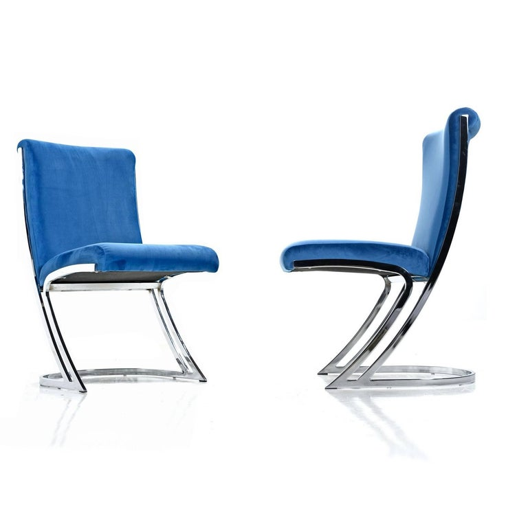 These exquisite chairs designed by Pierre Cardin scream sexy, and sleek with their dynamic angular