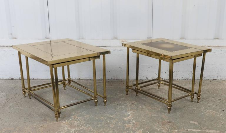 Pair of brass nesting tables.  Sizes Differ: Set one:  16 inches W x 20 inches; L x 16 inches H. 12 inches; W x 16 inches; L x 14.5 inches; H.  Set two: 18 inches W x 23.5 inches; L x 16 inches; H. 14 inches; W x 20 inches L x 14.5 inches H.