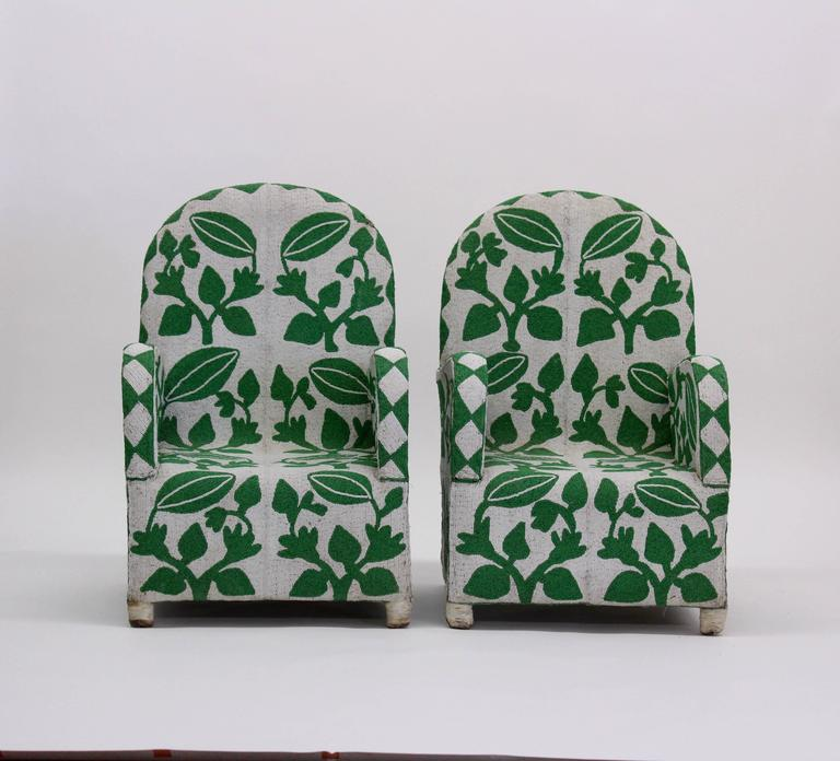 Whimsical, fabulous pair of vintage green and white African beaded armchairs with botanical design.