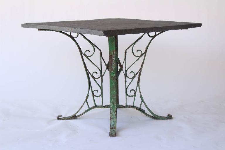 Vintage indoor or outdoor square table with green painted iron base and slate top from France in the 1920s.