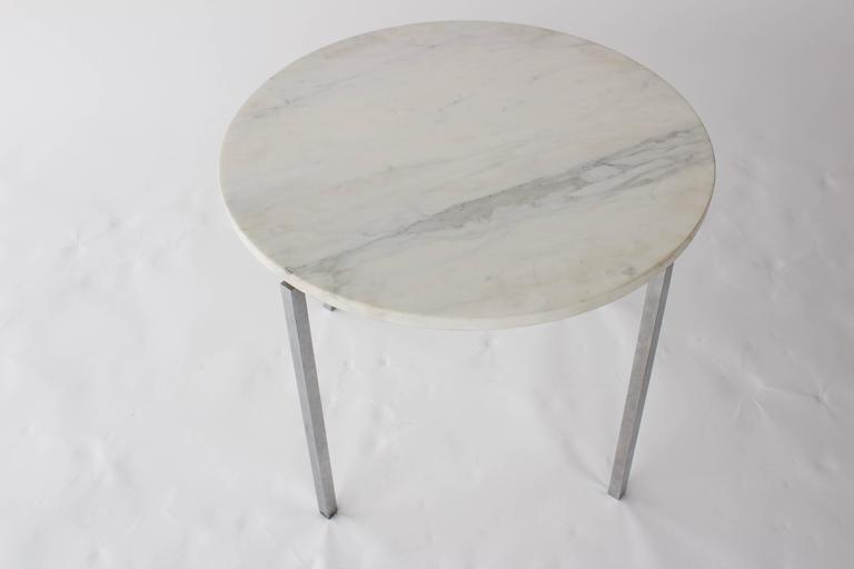 Simple, modern side table with marble and chrome steel base, attributed to Knoll, circa 1970s.