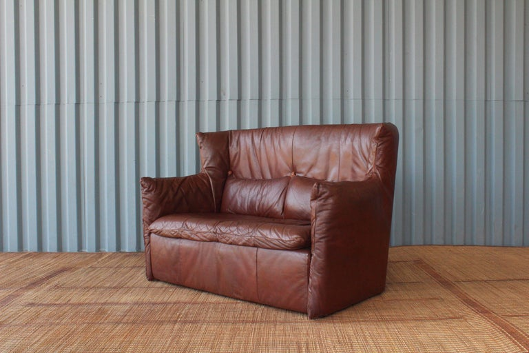 Beautiful leather loveseat designed by Gerard van den Berg for Montis, Netherlands. The leather has been aged exceptionally and was professionally reconditioned.
