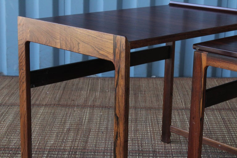 Set of three Danish rosewood nesting tables, circa 1960s. These tables are in wonderful condition and can be used in a handful of ways.