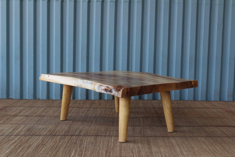 Custom-made raw edge coffee tables made of stunning camphor wood. Pair available.