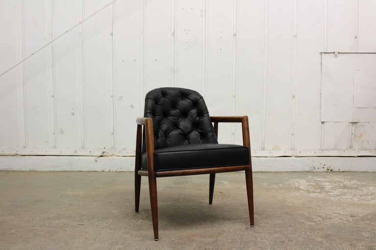 Walnut armchair with all new tufted leather, designed by T.H. Robsjohn-Gibbings.