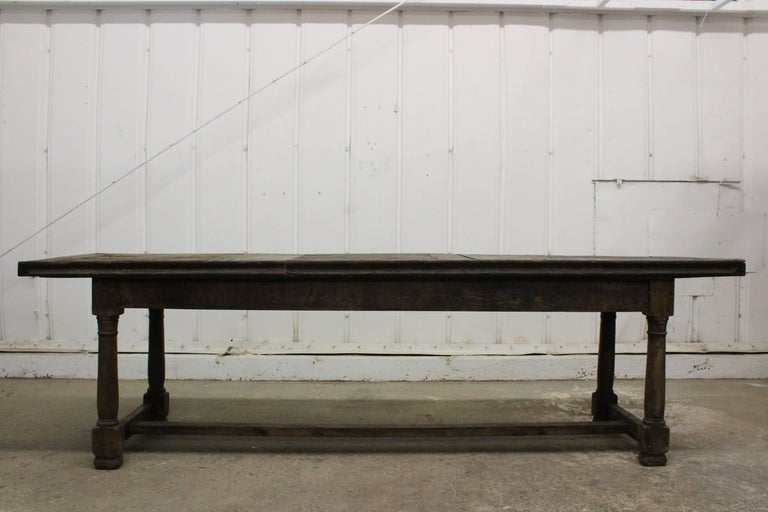 Antique 17th century refectory table made of English oak. This table is in it's original condition with heavy patina and signs of wear.
