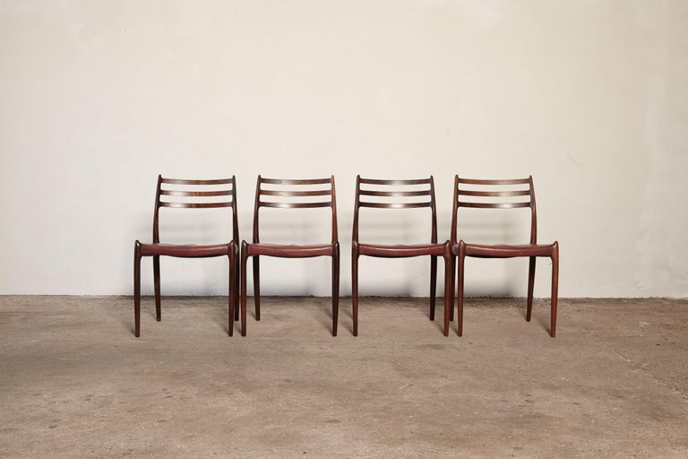 A beautiful set of four Niels O Møller model #78 rosewood dining chairs with original patinated leather seats, Denmark, 1960s. Produced by J.L. Moller Mobelfabrik in Denmark and stamped with makers mark. Excellent condition.