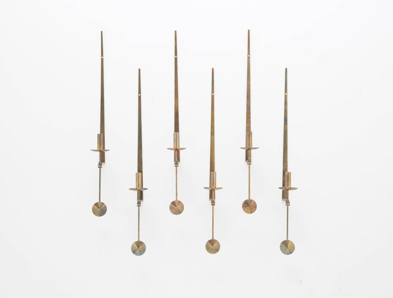 Pierre Forsell designed brass pendel wall appliques, collection of six. Rarer version with bobeche. Made by Skultuna, Sweden, circa 1965. In beautiful original patinated condition. Stamped with makers mark.