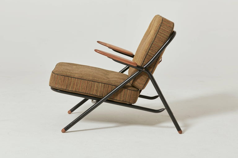 Rare Hans Wegner GE215 Sawbuck chair, Denmark, 1950s. Excellent condition. Ships worldwide.  This chair was shown at the 1955 great Nordic design exhibition in Helsingborg, Sweden. In this Wegner combined diverse materials, into one harmonious