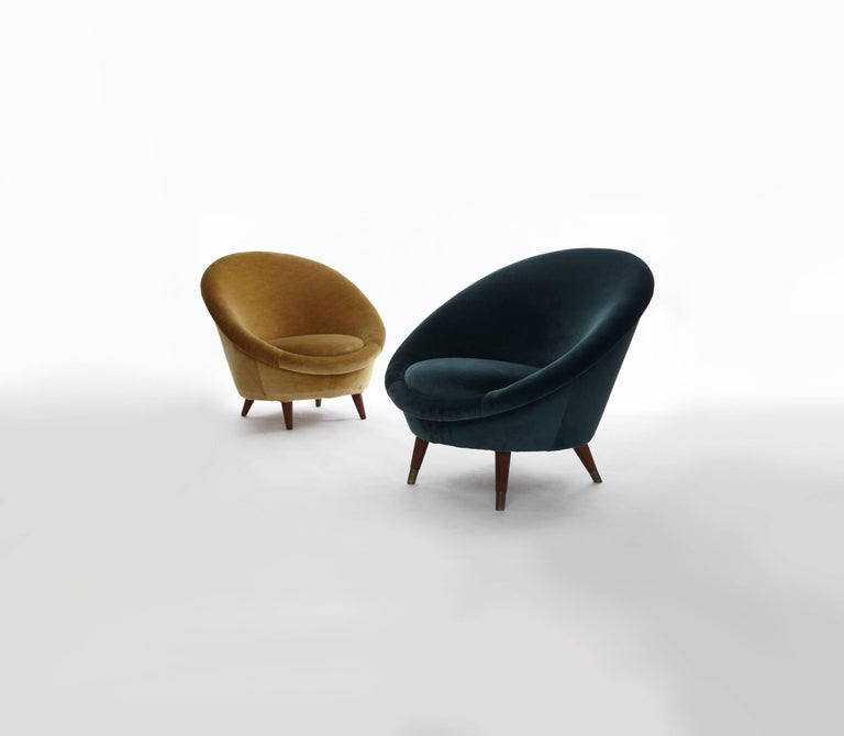 A pair of rare 1950s Norwegian egg chairs, upholstered in velvet. Fabric on the golden chair shows some wear and marks. Re-upholstery available upon request at an extra charge.