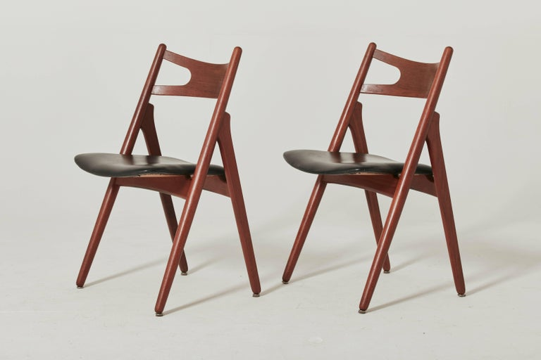 Set of six Hans Wegner CH-29 sawbuck dining chairs, designed in 1951, and made by Carl Hansen, Denmark. Teak frames.   We offer a recovering service for these chairs if you would prefer a different seat cover.   Ships worldwide - please contact us