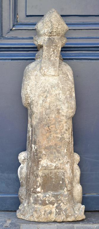 Beautiful 16th century statue of St. Nicholas in carved stone.