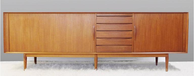 Teak sideboard with rolling doors.