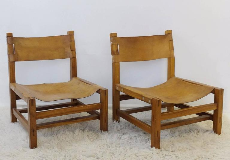 Pair Of Solid Elm And Cognac Leather Low Chairs By Maison